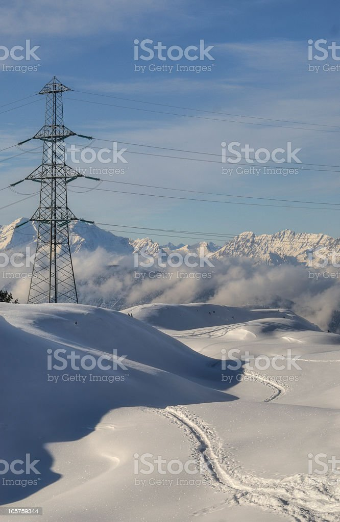 Powerline on a snow mountain royalty-free stock photo