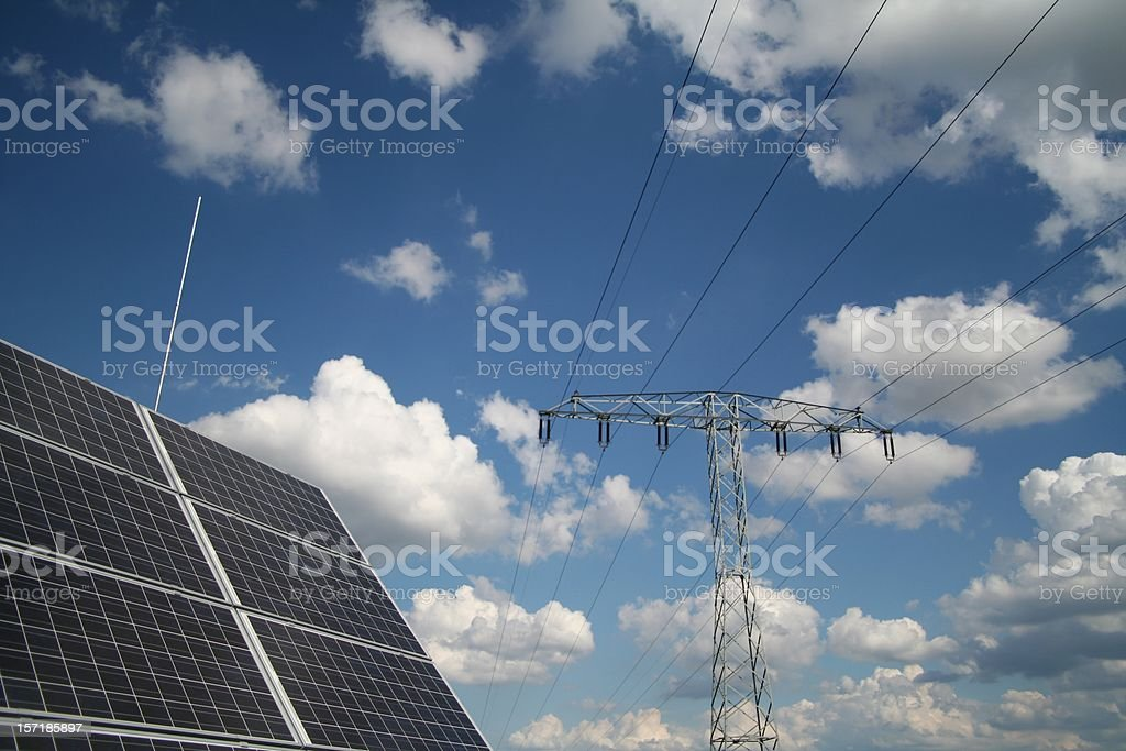 Powerlines and solar panel royalty-free stock photo