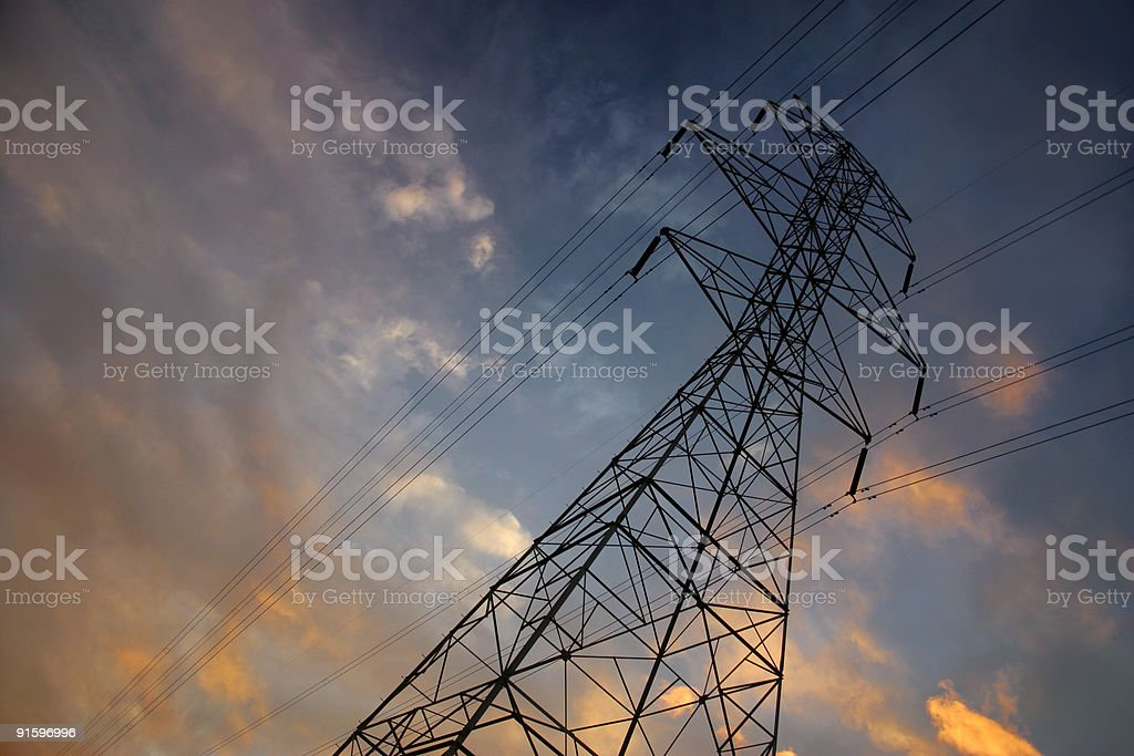 Powerlines at sunset stock photo