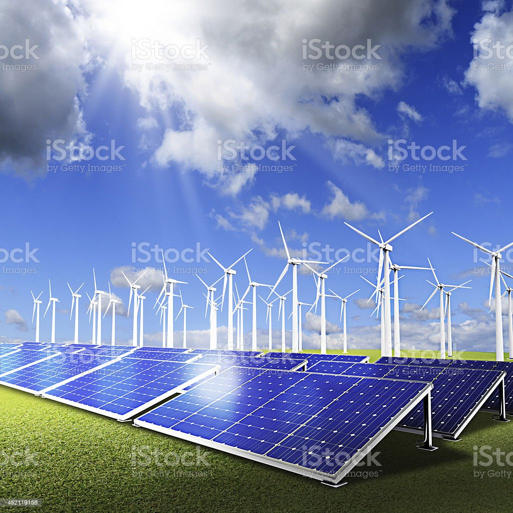 Powerplant with photovoltaic panels and eolic turbine on blue sk stock photo