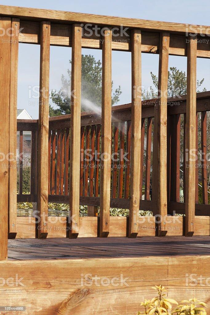 Powerwashing a Deck - FAR FOCUS XXXL royalty-free stock photo