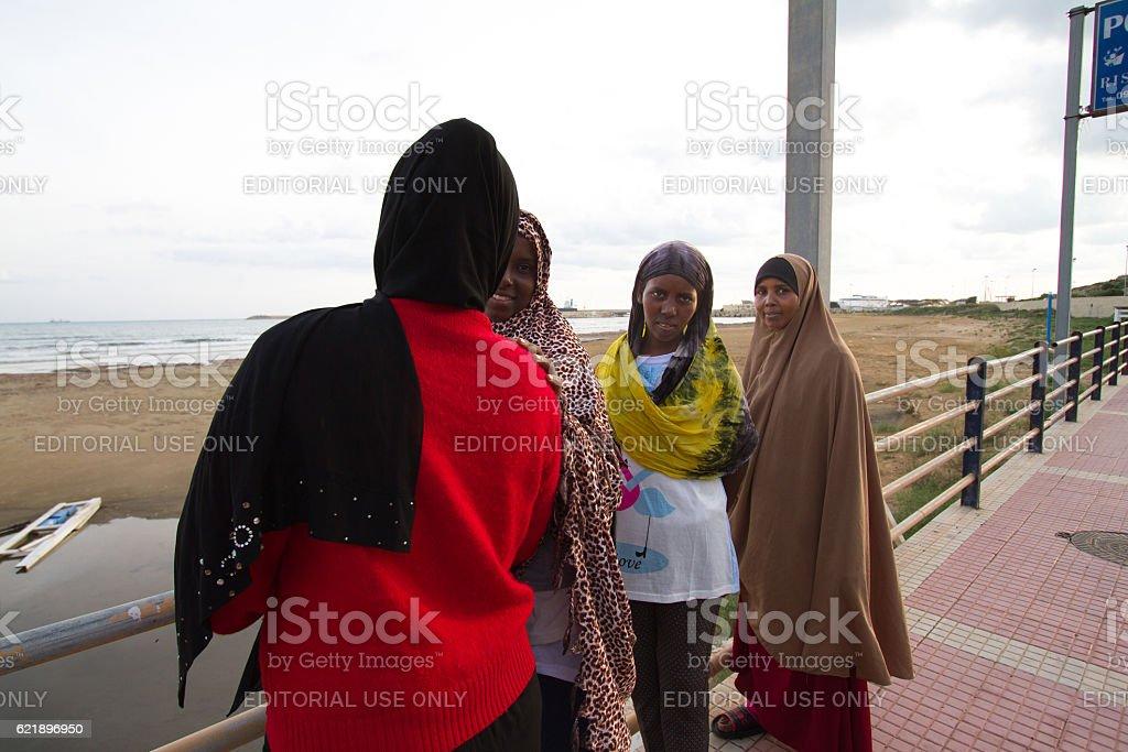 Pozzallo, Sicily: Just-Arrived Somali Female Migrants on Beach stock photo