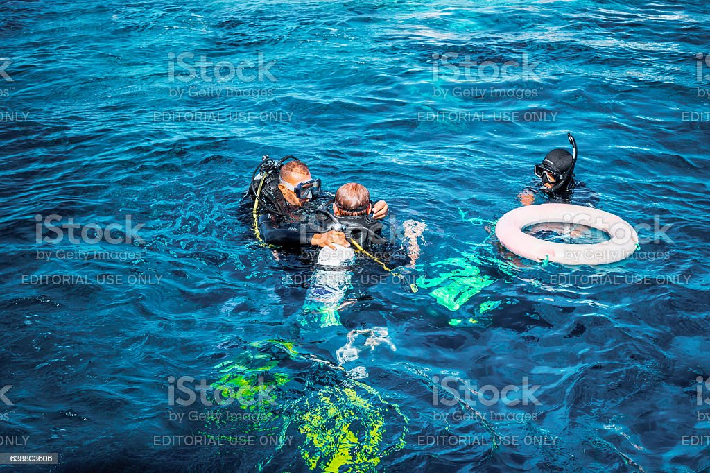 Practice diving. Sports instructor and the student stock photo