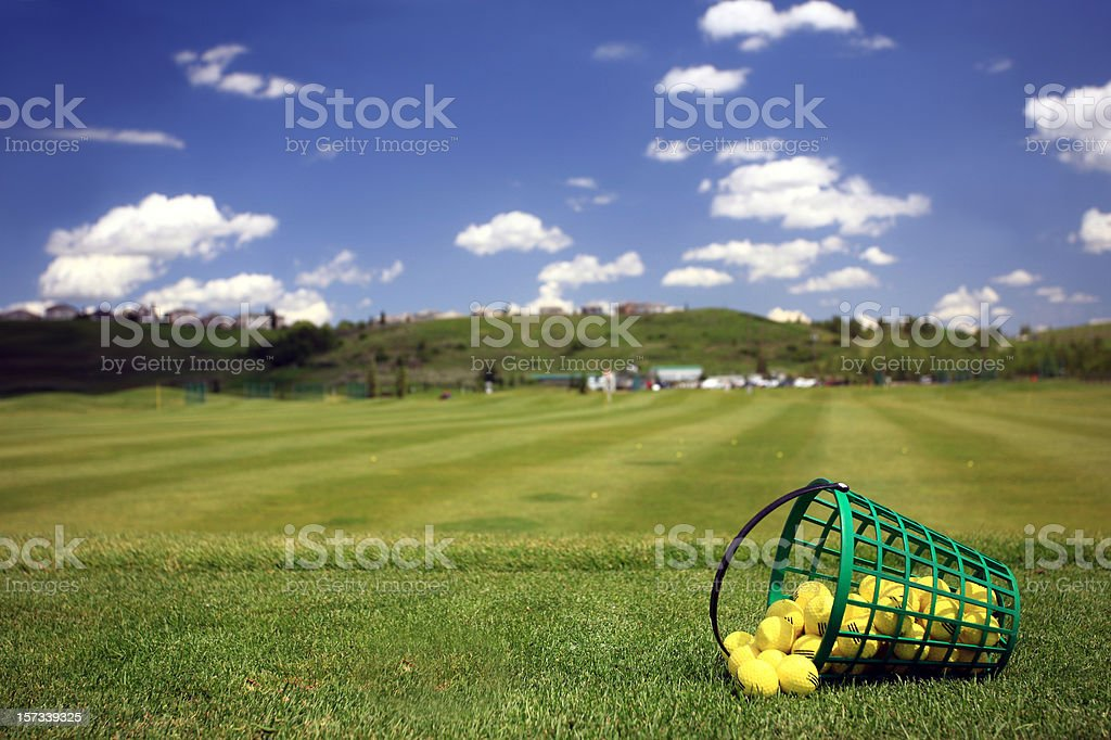 Practice Golf Balls and Bucket at Driving Range stock photo