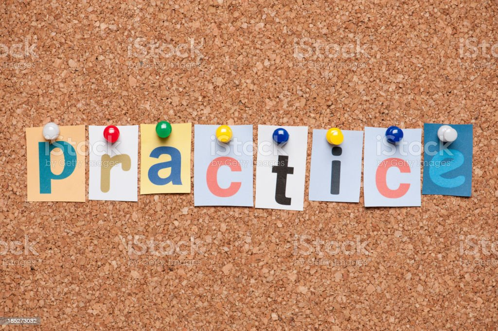 Practice letters on corkboard royalty-free stock photo