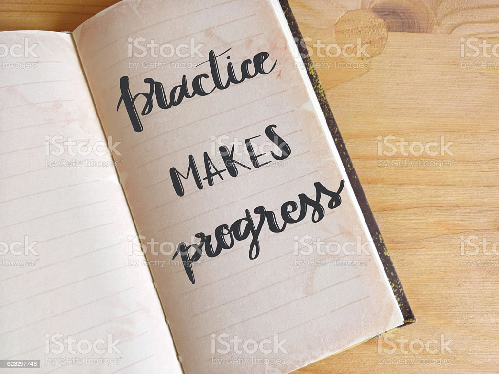 Practice makes progress written on open agenda stock photo