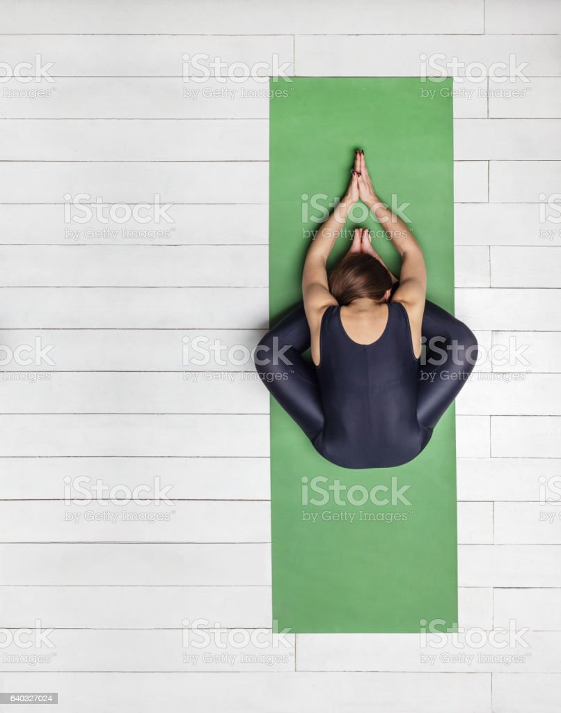 practice of yoga on green carpet and white wooden floor stock photo