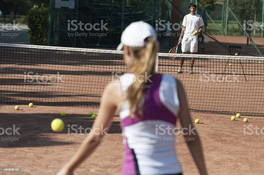 practice session coach and female player royalty-free stock photo