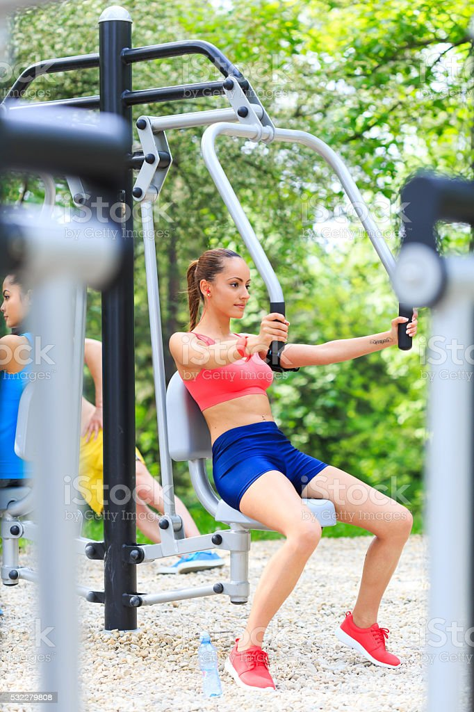 Practice with chest press in the park stock photo