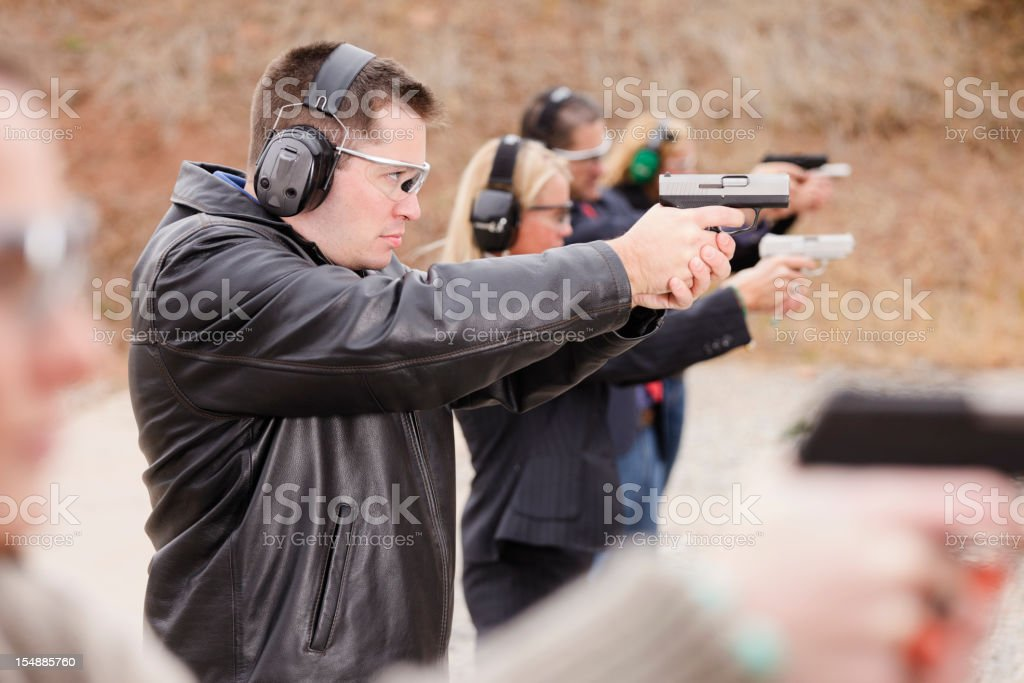 Practicing at the Shooting Range stock photo