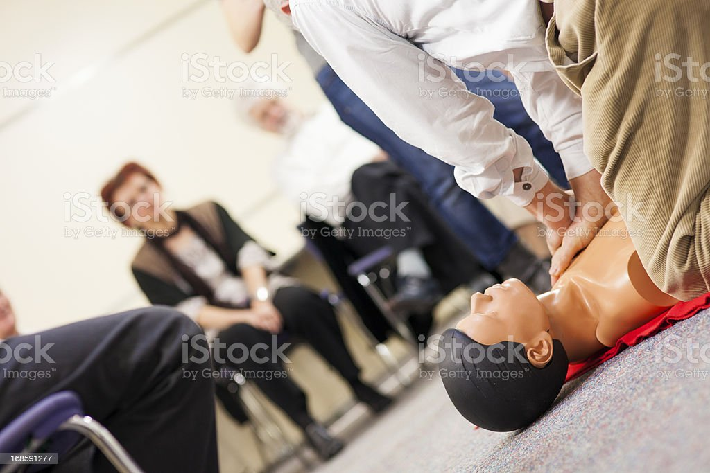Practicing Chest Compressions stock photo