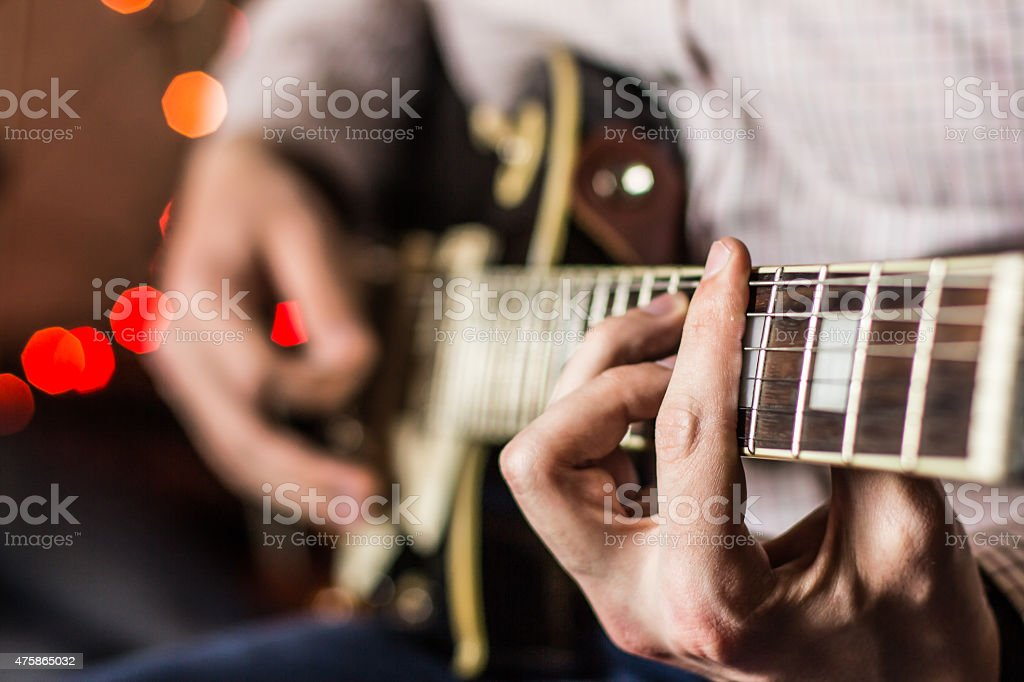 Practicing in playing guitar stock photo