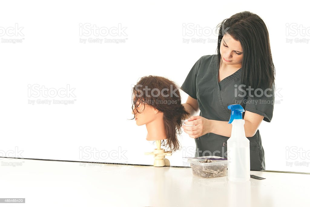 Practicing Student Hair Stylist stock photo