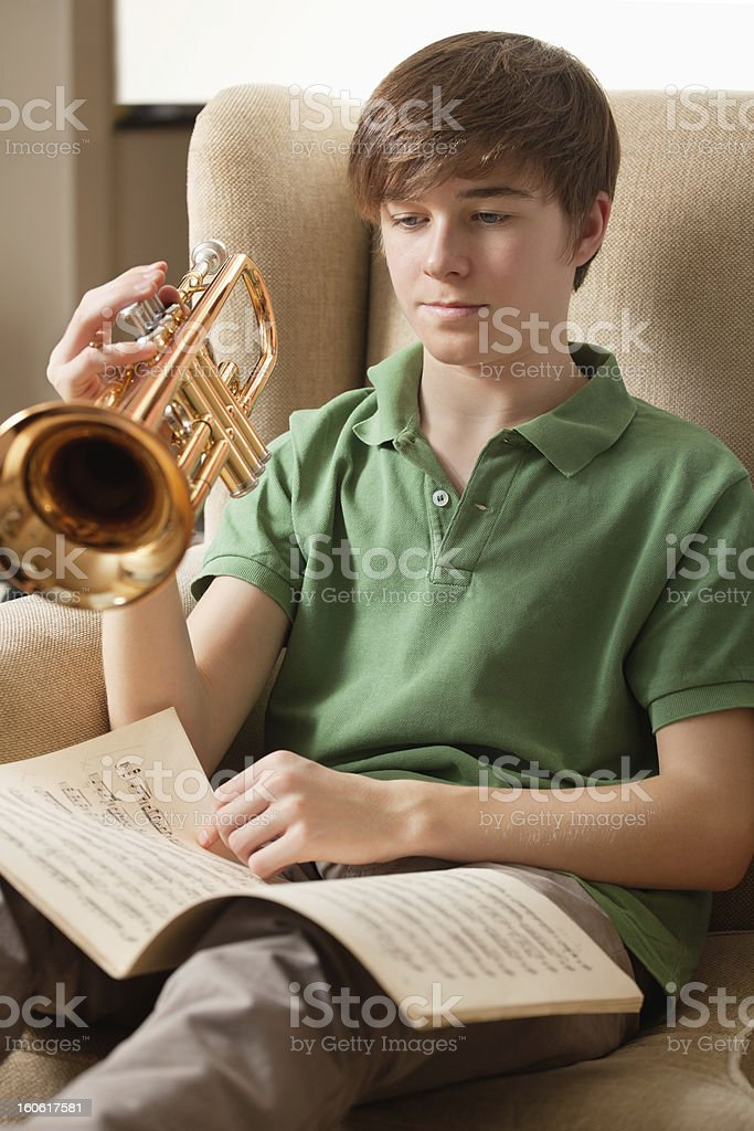 Practicing the trumpet at home royalty-free stock photo