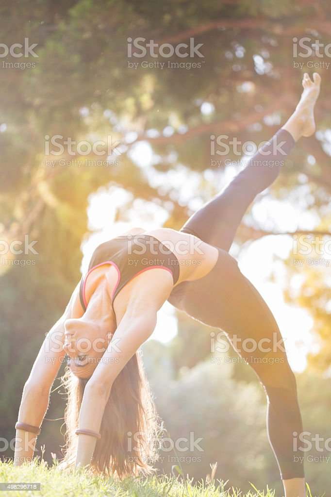 Practicing yoga and acroyoga outdoors in Barcelona stock photo