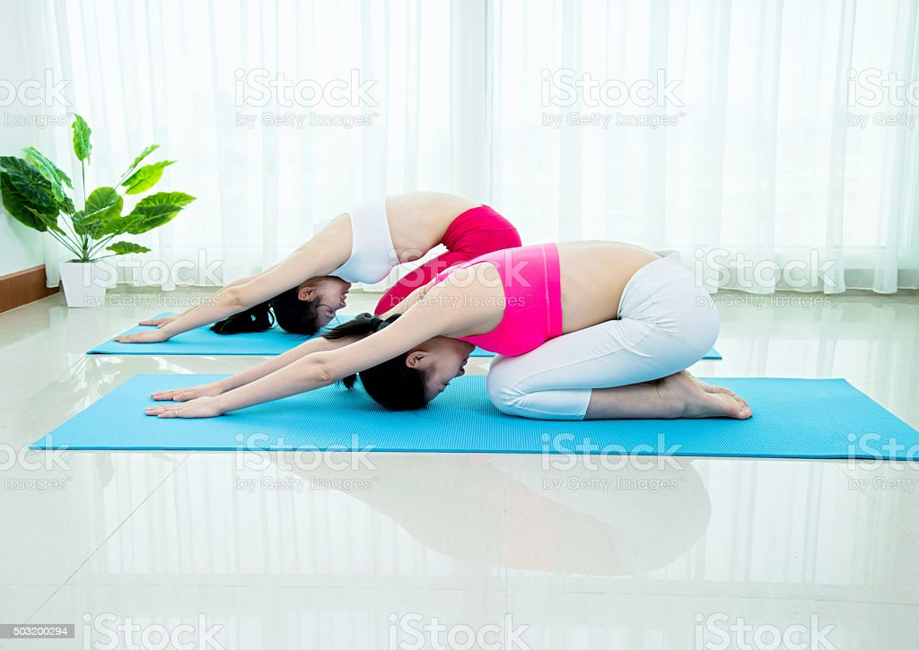Practicing yoga child pose stock photo