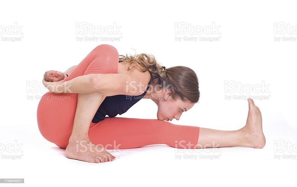 Practicing Yoga exercises / Ray of Light Pose - Marichyasana stock photo