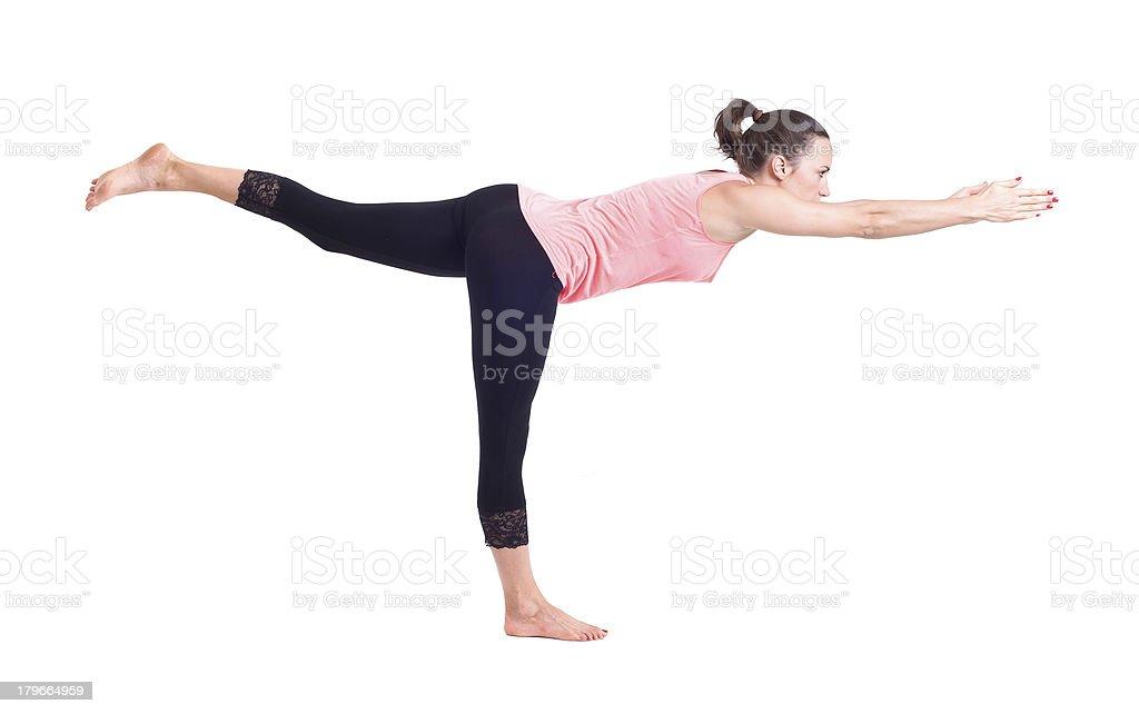 Practicing Yoga exercises:  Warrior Pose - Virabhadrasana royalty-free stock photo
