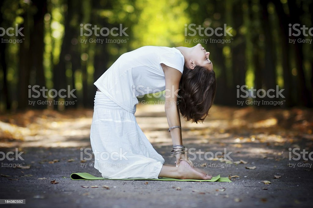 Practicing yoga in the forest stock photo