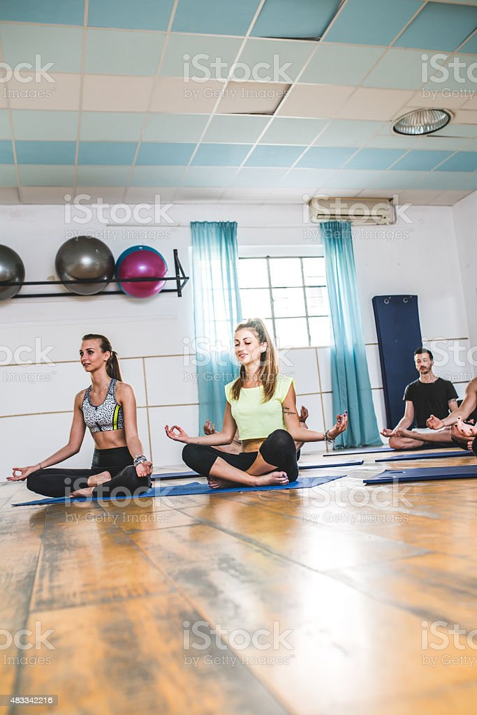 Practicing Yoga In The Gym stock photo