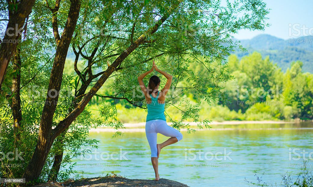 Practicing yoga in the morning stock photo