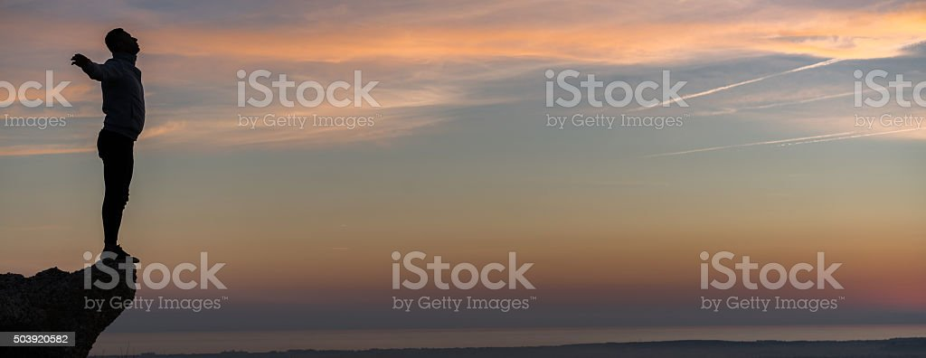 Practicing yoga outdoors in beautiful sunset stock photo