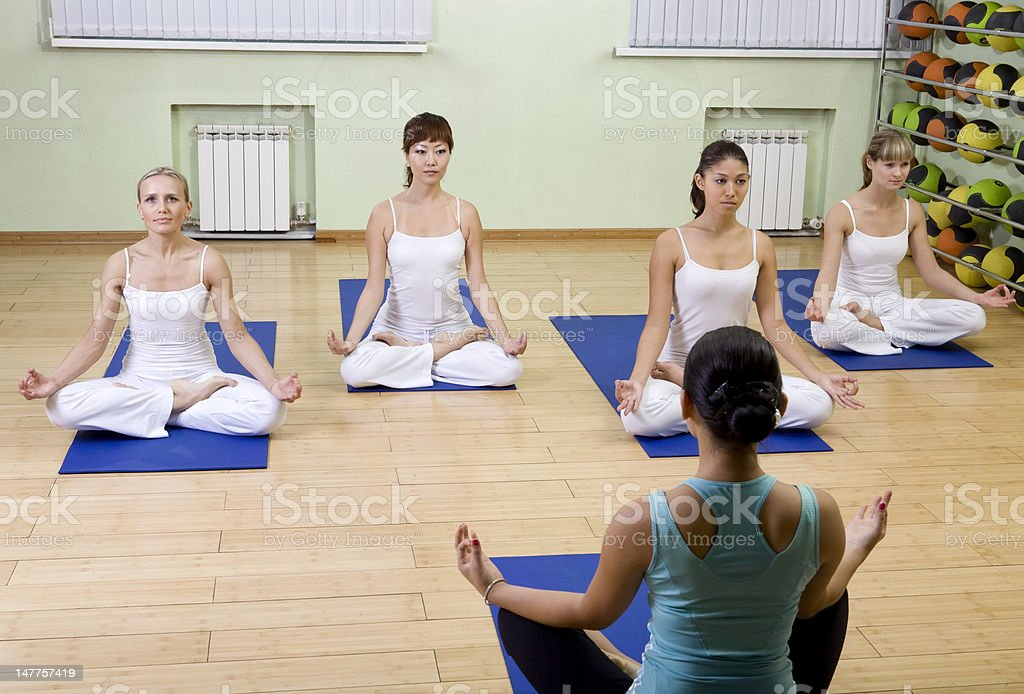 Practicing Yoga with an Instructor. royalty-free stock photo