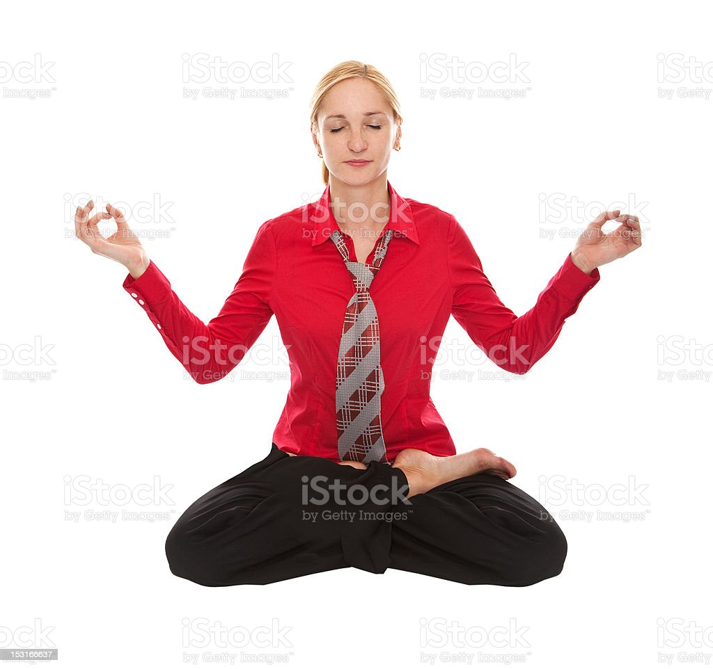 Practicing Yoga. Young businesswoman royalty-free stock photo