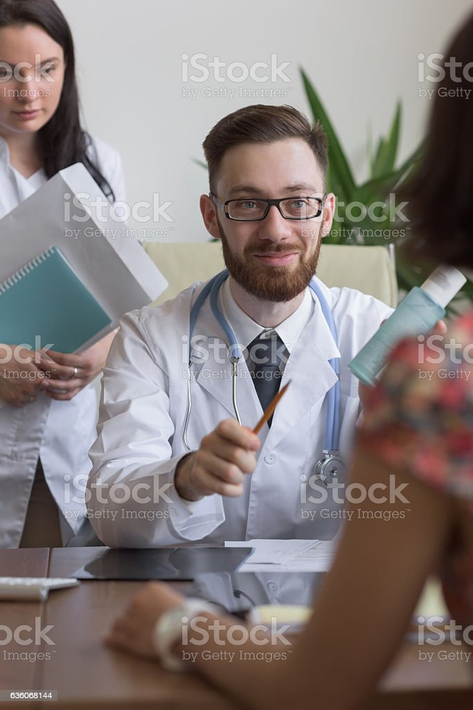 Practitioner consulting woman stock photo