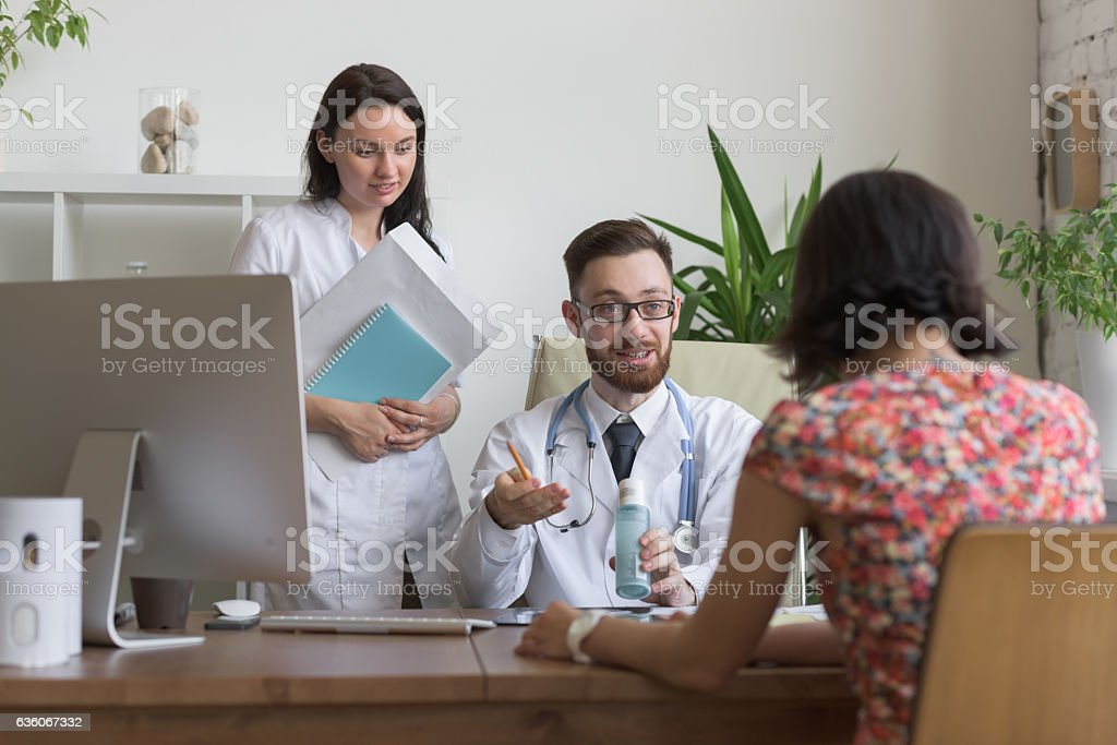 Practitioners consulting woman stock photo
