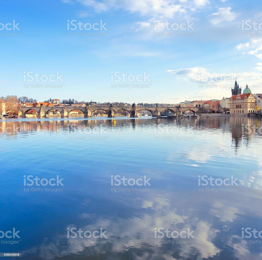 Prague, Charles bridge reflected in Vltava river stock photo