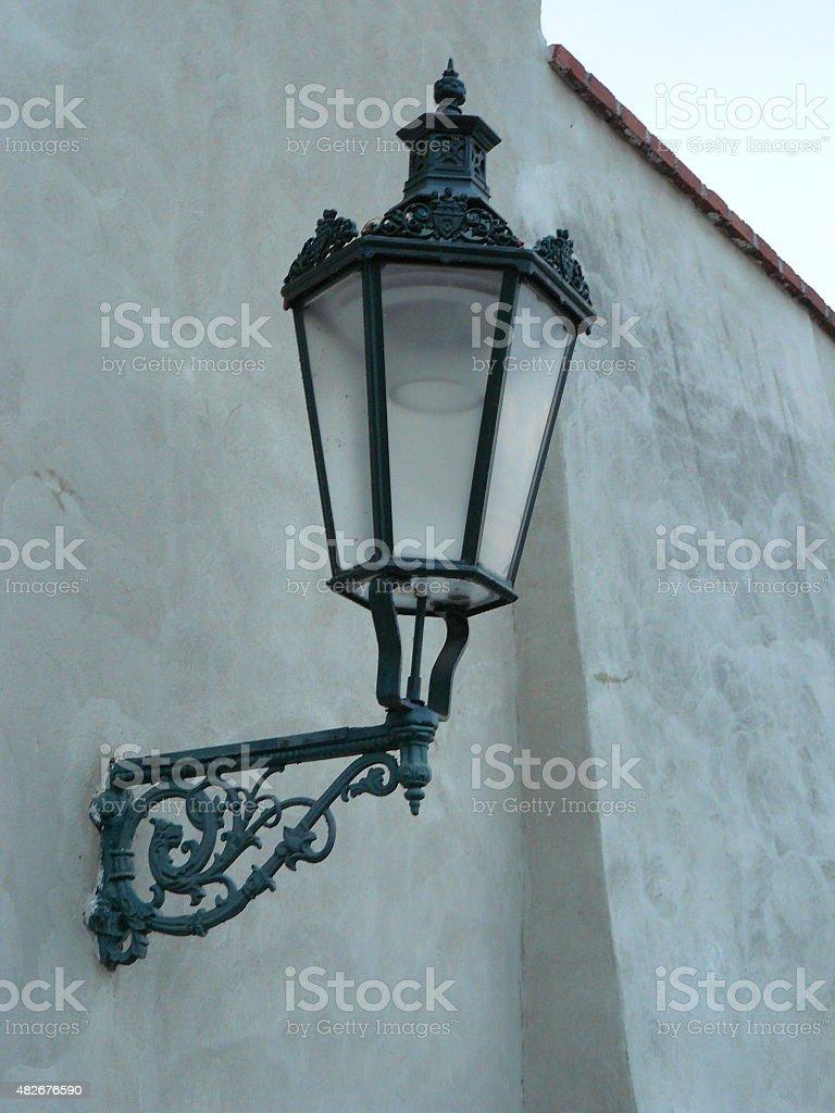 Praha, city street detail lamp on wall stock photo