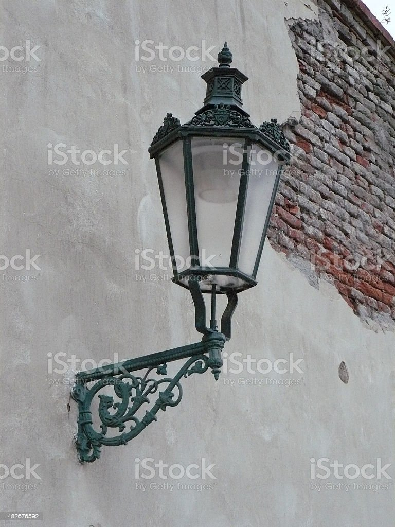Praha, city street detail lamp on wall with bricks stock photo