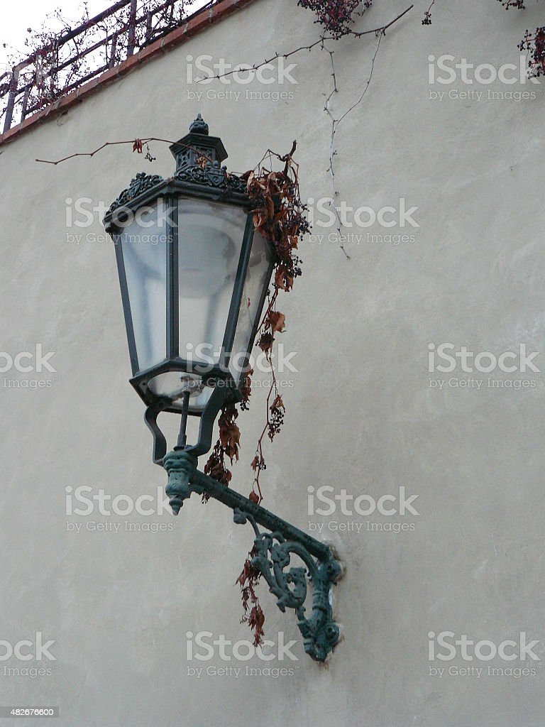 Praha, city street detail lamp on wall with red stock photo