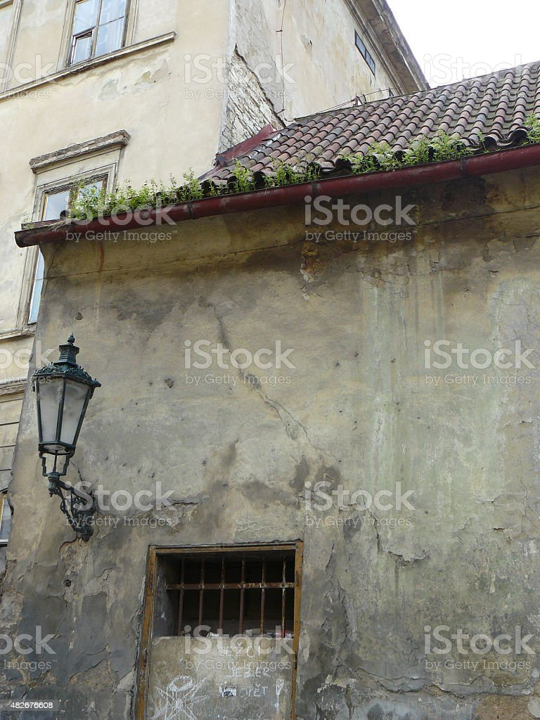 Praha, city street detail lamp on wall with rooftops stock photo