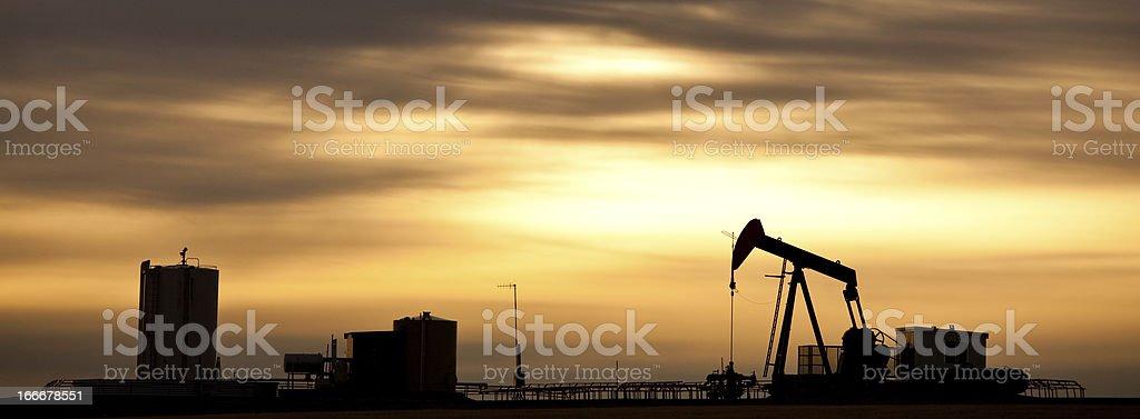 Prairie Pumpjack Silhouette in Panorama stock photo