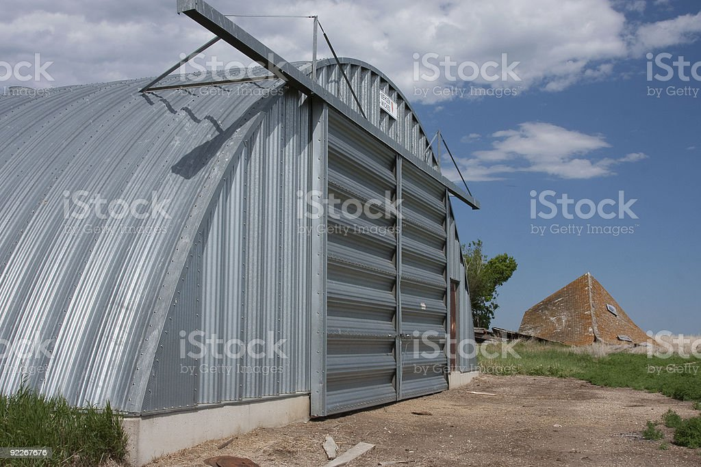 Prairie Quonset with fallen down house royalty-free stock photo