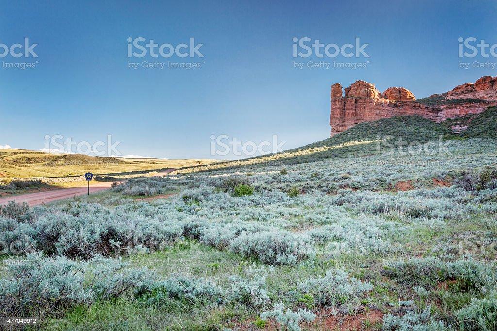 prairie, shrubland and sandstone stock photo