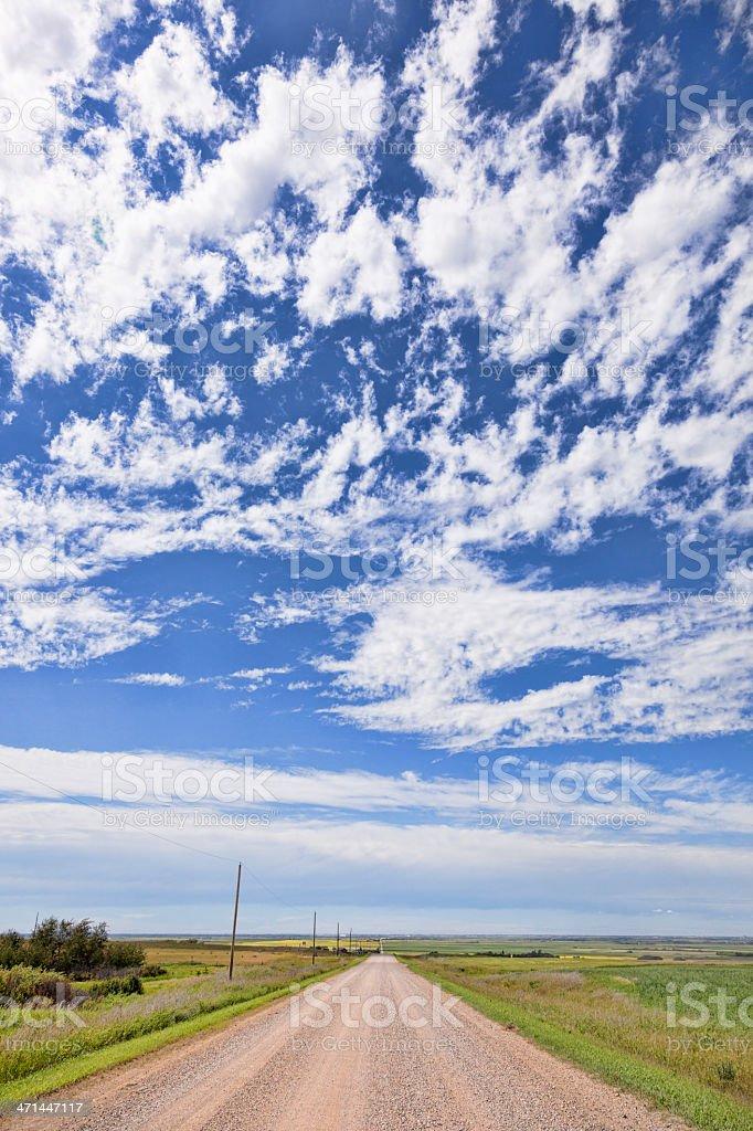 Prairie Sky Above Gravel Road royalty-free stock photo