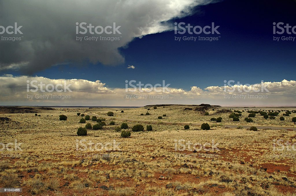 Prairie under dark blue sky and clouds royalty-free stock photo