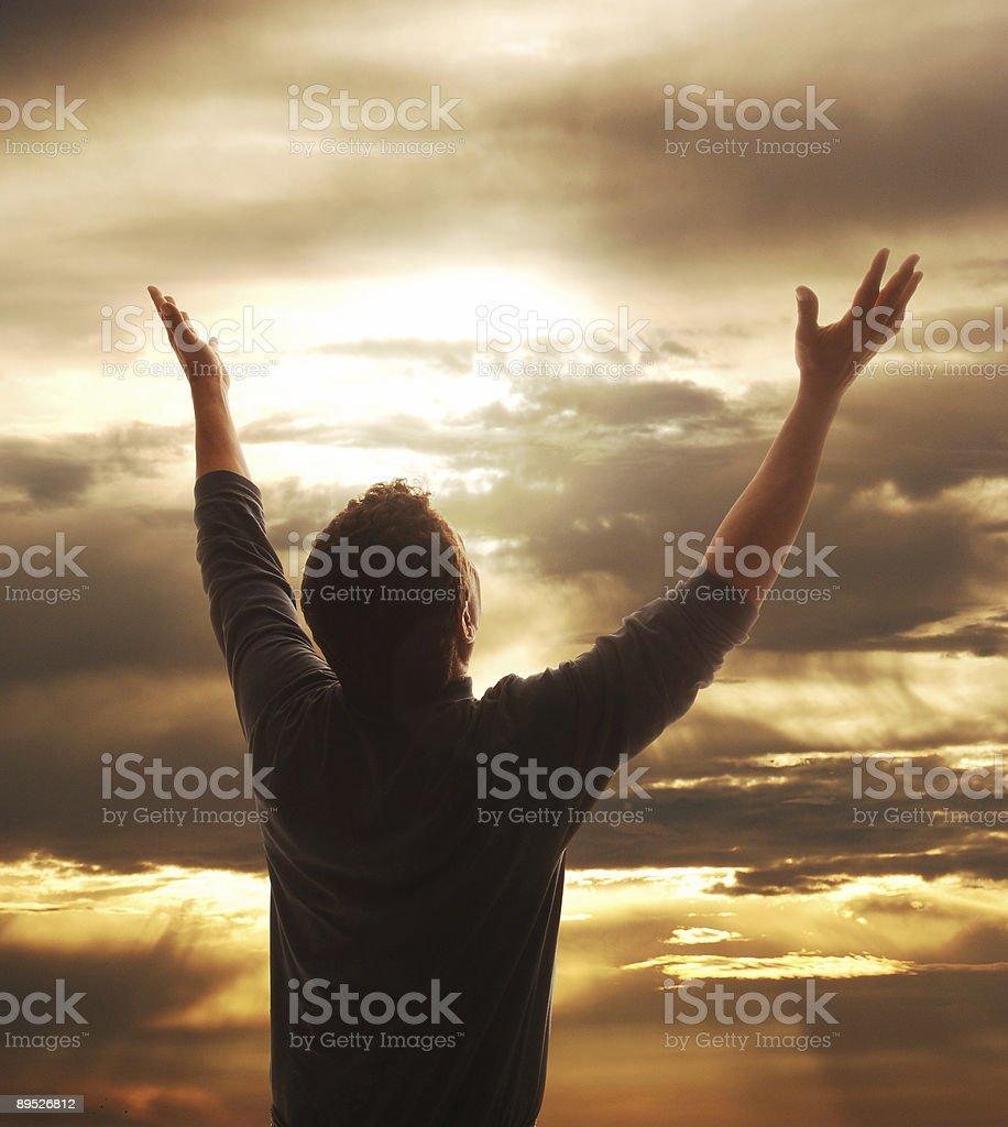Praising man stock photo