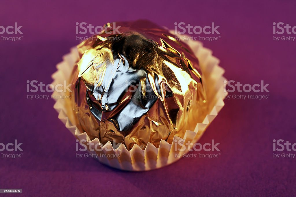 Praline on purple background royalty-free stock photo