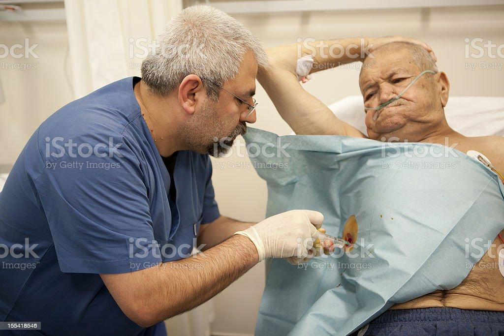 praparin to insert a chest tube stock photo