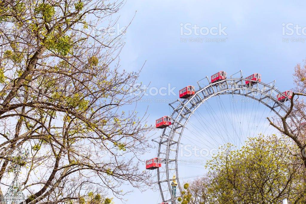 Prater Wheel, Vienna, Austria among spring green trees stock photo
