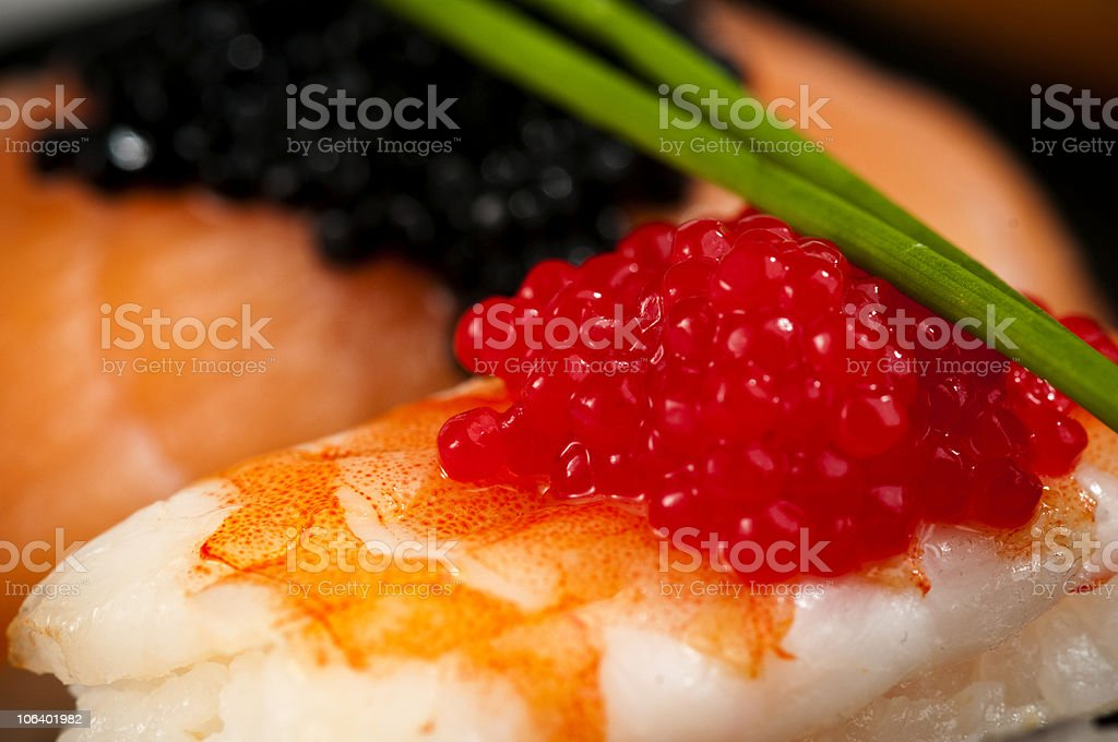 Prawn and salmon sushi with red, black fish eggs. royalty-free stock photo