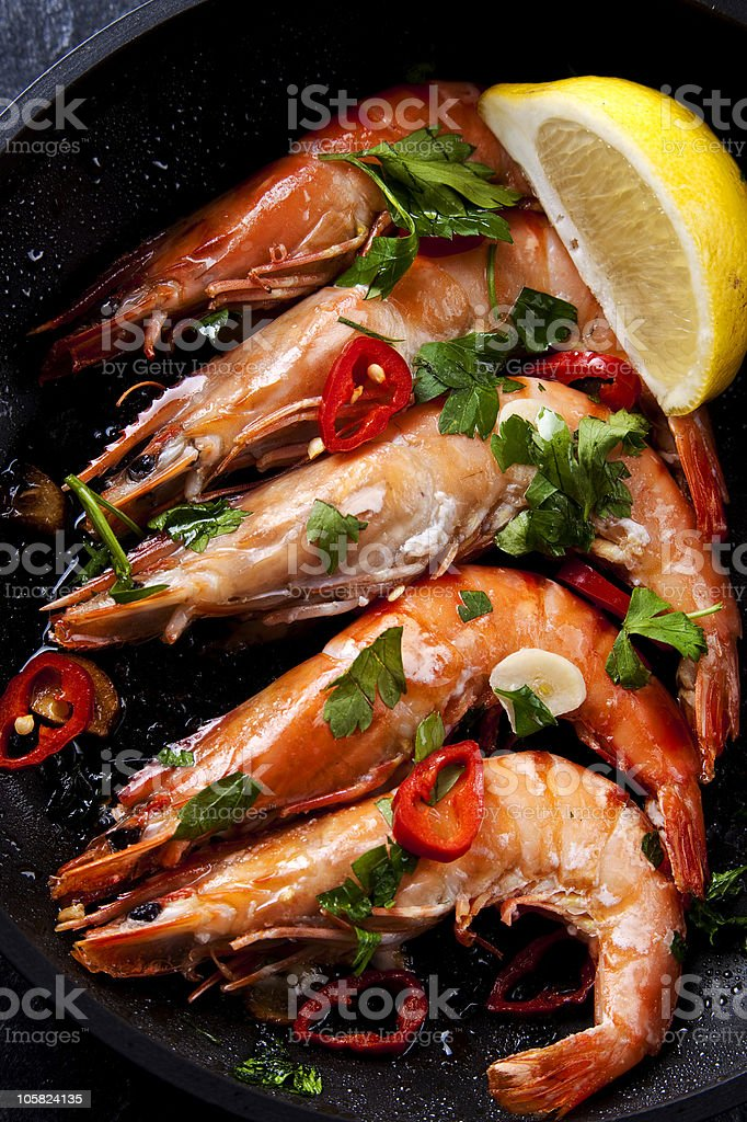 Prawn chili covered with spices and lemon royalty-free stock photo