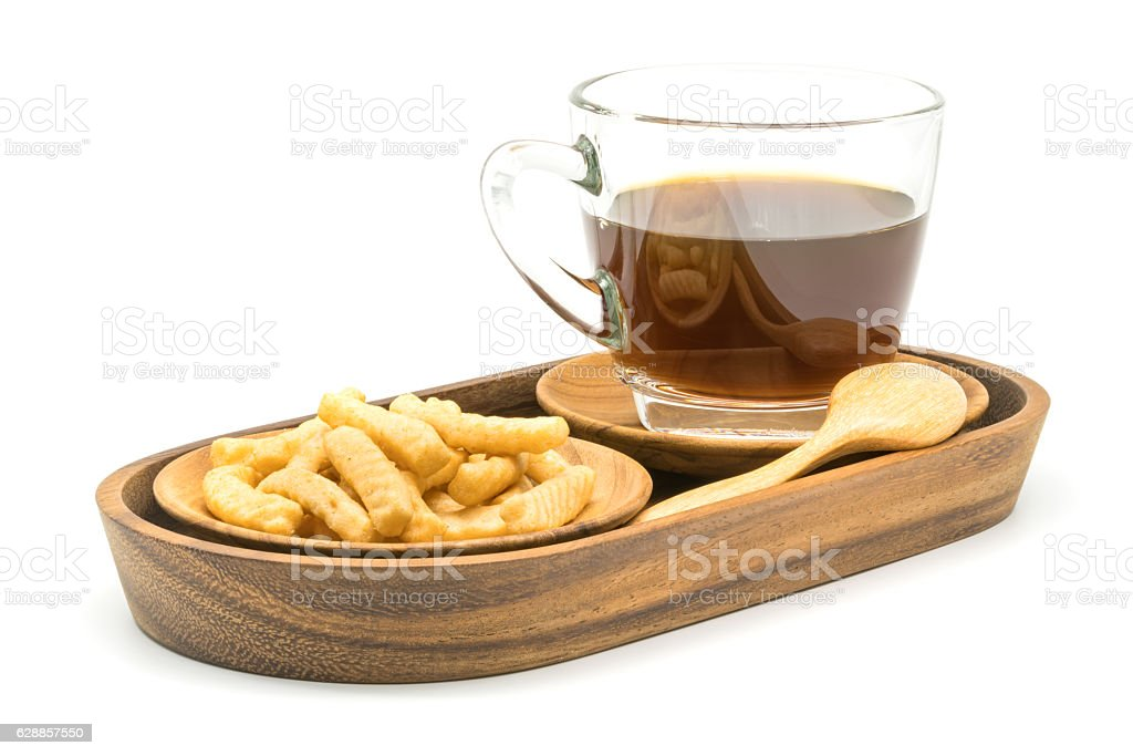 Prawn cracker and a cup of coffee in wooden tray stock photo