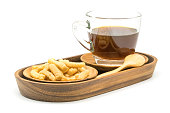 Prawn cracker and a cup of coffee in wooden tray