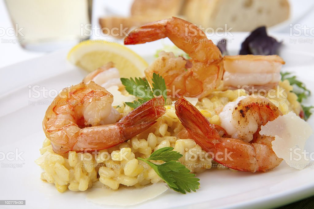 Prawn risotto garnished with lemon and parsley royalty-free stock photo