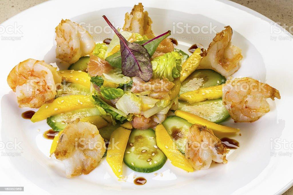 Prawn salad with mango, smock salmon, cucumber, balsamic vinegar royalty-free stock photo